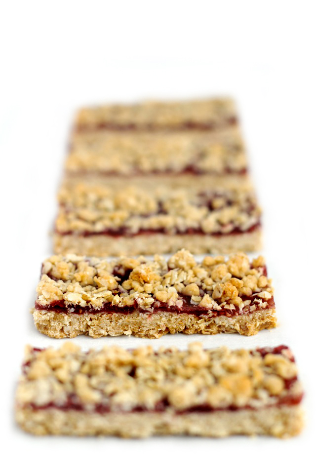 chocolate covered raspberry oat bars . - . running with spoons .