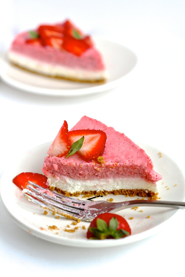High in protein, low in fat, low in sugar, and roughly 150 calories per slice -- this No Bake Strawberry Cheesecake makes a perfect cool and creamy summer treat! || runningwithspoons.com