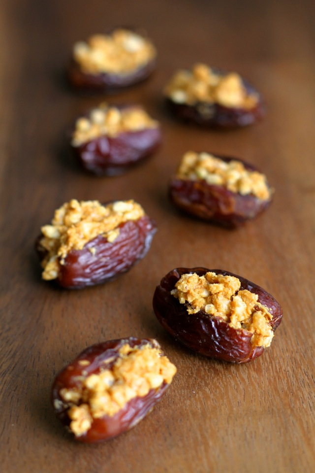 A crispy nutty filling stuffed into a sweet and gooey shell -- these Rice Krispie Stuffed Dates are a perfect way to satisfy that sweet tooth! || runningwithspoons.com