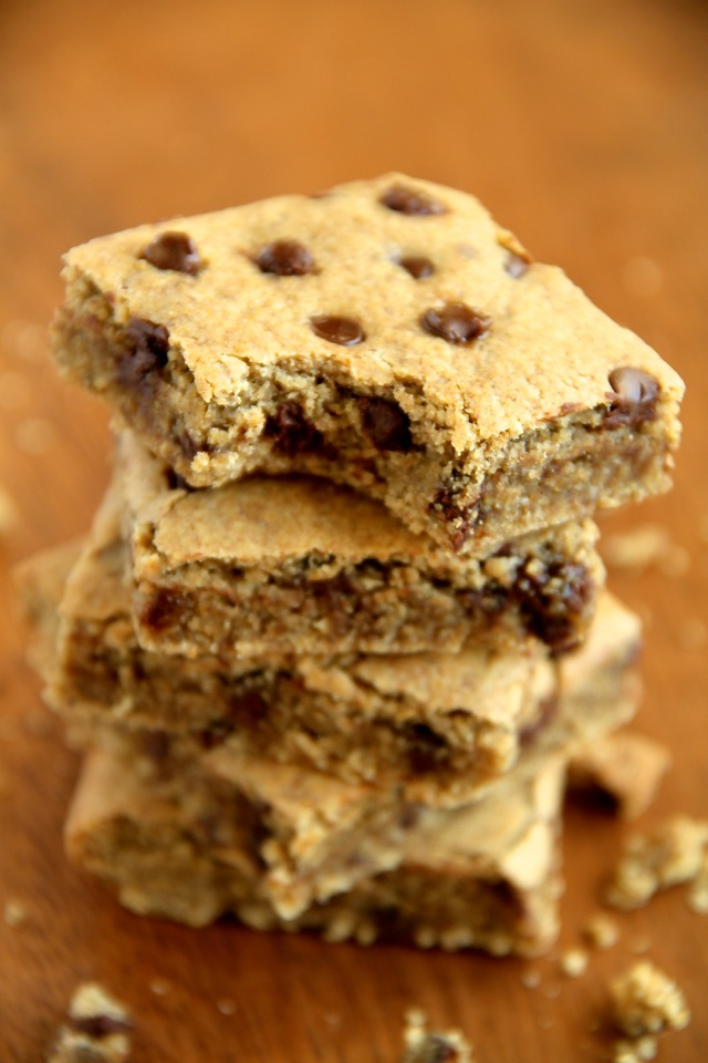 Chocolate Chip Cookie Dough Bars -- these soft and chewy vegan cookie dough bars are naturally sweetened with dates and maple syrup! Healthy and delicious, they're a great way to satisfy those cookie cravings!    runningwithspoons.com