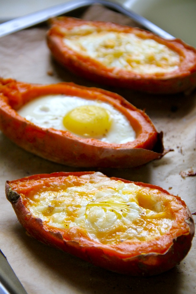 These quick and easy Baked Egg Stuffed Sweet Potatoes are a perfect choice for those nights where you don't have a lot of time or energy to put into cooking. Gluten-free and vegetarian, they make a healthy and balanced meal with minimal hands-on time and no cleanup!    runningwfithspoons.com #vegetarian #glutenfree #healthy #dinner