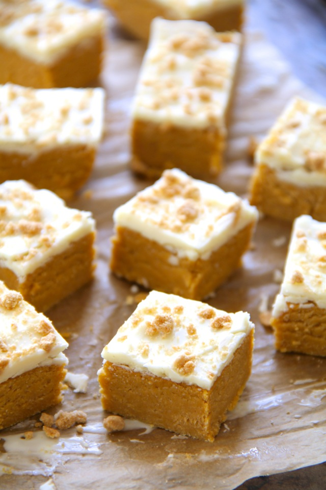 These soft and creamy No Bake Pumpkin Cheesecake Bites combine the tanginess of cheesecake with the spicy sweetness of pumpkin pie. Easily made gluten-free or vegan depending on your dietary needs, they're an irresistible fall treat that everyone will love! || runnningwithspoons.com #pumpkin #cheesecake #nobake