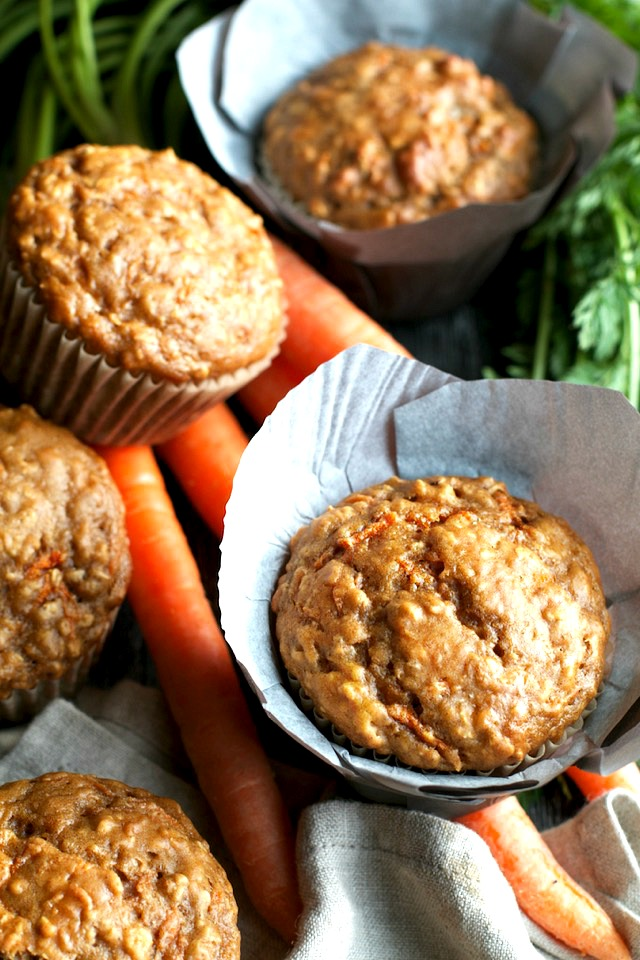 You won't find any butter or oil in these ridiculously soft and tender Carrot Oatmeal Greek Yogurt Muffins! What you will find is plenty of naturally sweetened, carrot-y goodness in each bite! | runningwithspoons.com #healthy #muffins #breakfast #snack