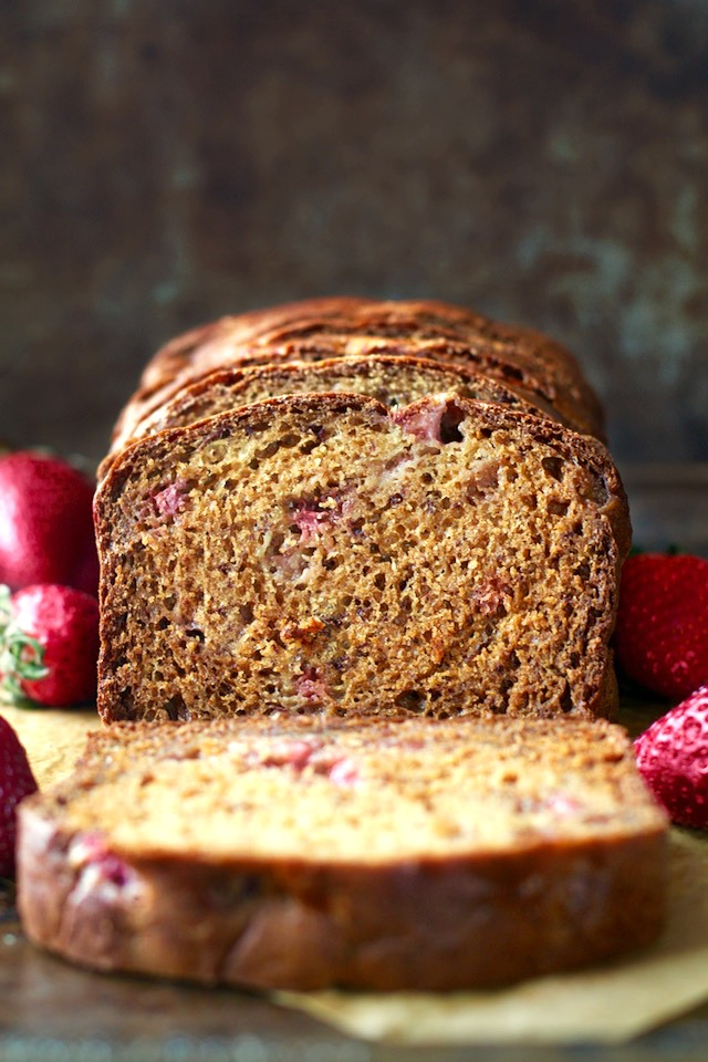Strawberry Greek Yogurt Banana Bread -- soft, tender, and loaded with strawberries and banana in each bite! You'd never be able to tell it's made without butter or oil! | runningwithspoons.com #recipe #healthy
