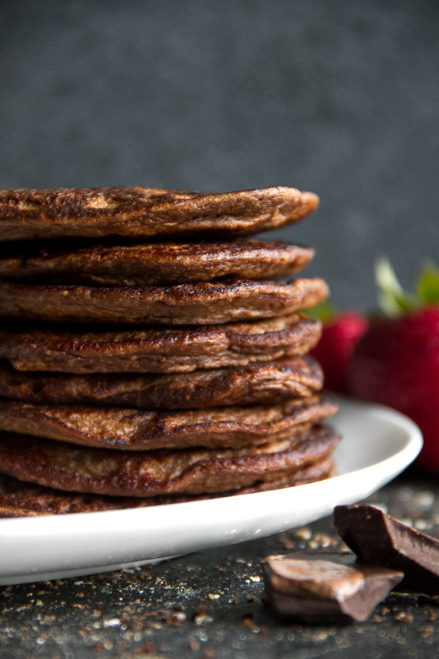 Healthy Double Chocolate Greek Yogurt Pancakes - light, fluffy, and loaded with chocolate flavour! These healthy blender pancakes will keep you satisfied all morning with over 26g of whole food protein. | runningwithspoons.com #recipe #glutenfree #breakfast