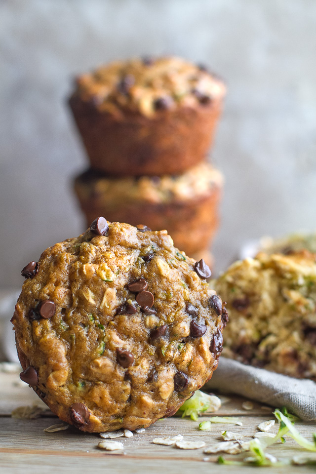 You won't find any butter or oil in these ridiculously soft and tender Zucchini Oat Greek Yogurt Muffins! They're naturally sweetened and perfect for breakfast or healthy snacking. | runningwithspoons.com #recipe #snack #summer