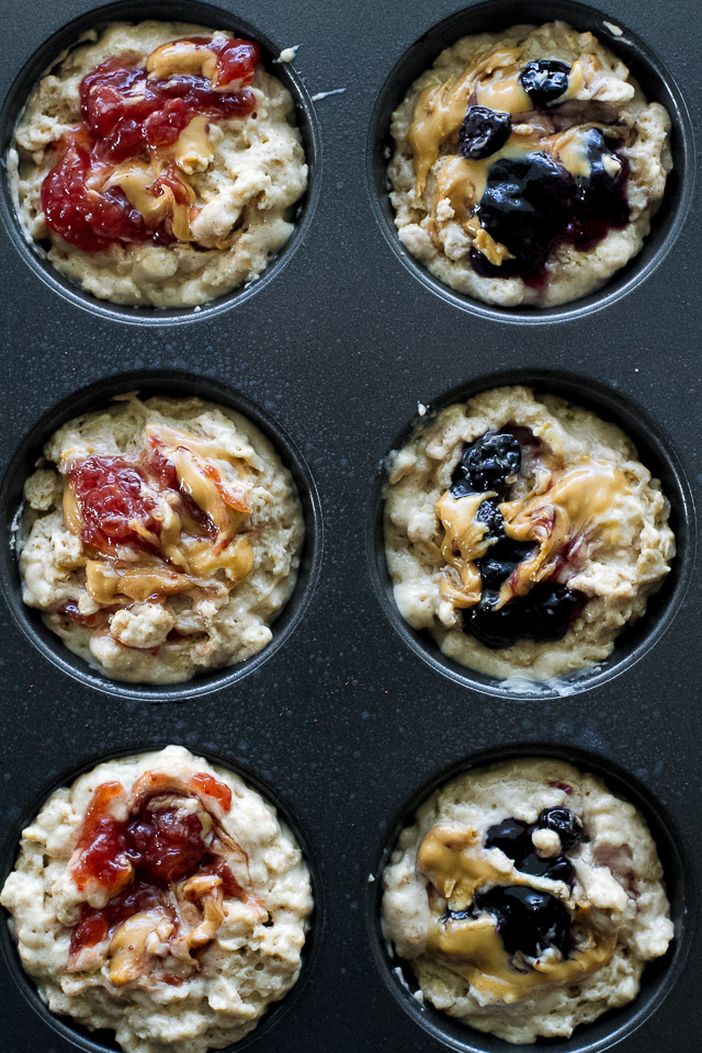 You won't find any butter or oil in these healthy Almond Butter & Jelly Muffins! The recipe calls for Greek yogurt to keep them soft and tender, with swirls of almond butter and jelly to add tonnes of flavour.   runningwithspoons.com