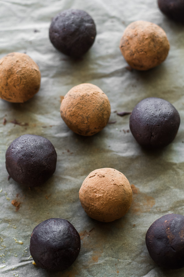 These melt-in-your-mouth No Bake Chocolate Fudge Protein Truffles taste SUPER decadent but are packed with good-for-you ingredients. They're a healthy way to satisfy those chocolate cravings and make a delicious pre or post-workout snack | runningwithspoons.com #recipe #vegan #glutenfree