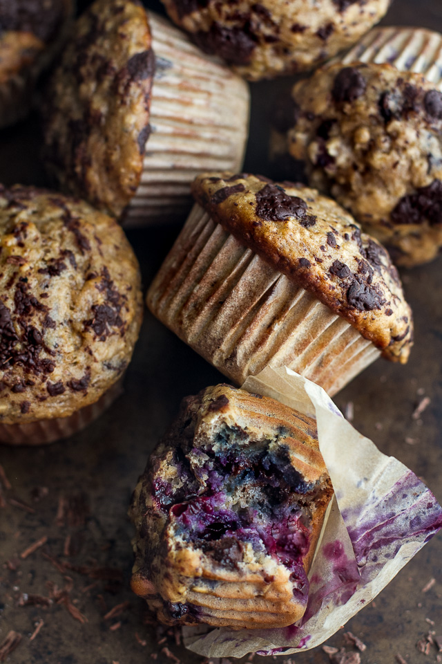 You won't find any butter or oil in these Dark Chocolate Blueberry Banana Oat Muffins! Just plenty of chocolate and blueberry flavour in a healthy soft and tender banana oat muffin | runningwithspoons.com