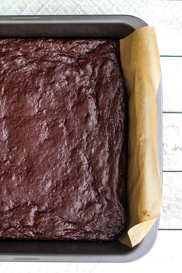 These flourless double chocolate zucchini brownies are gluten-free, grain-free, oil-free, dairy-free, and refined sugar-free, but so tender and chocoately that you'd never be able to tell they're healthy! | runningwithspoons.com