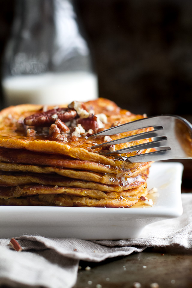 Sweet Potato Greek Yogurt Pancakes that are sure to keep you satisfied all morning with almost 20g of whole food protein! A healthy, easy, and delicious breakfast. | runningwithspoons.com
