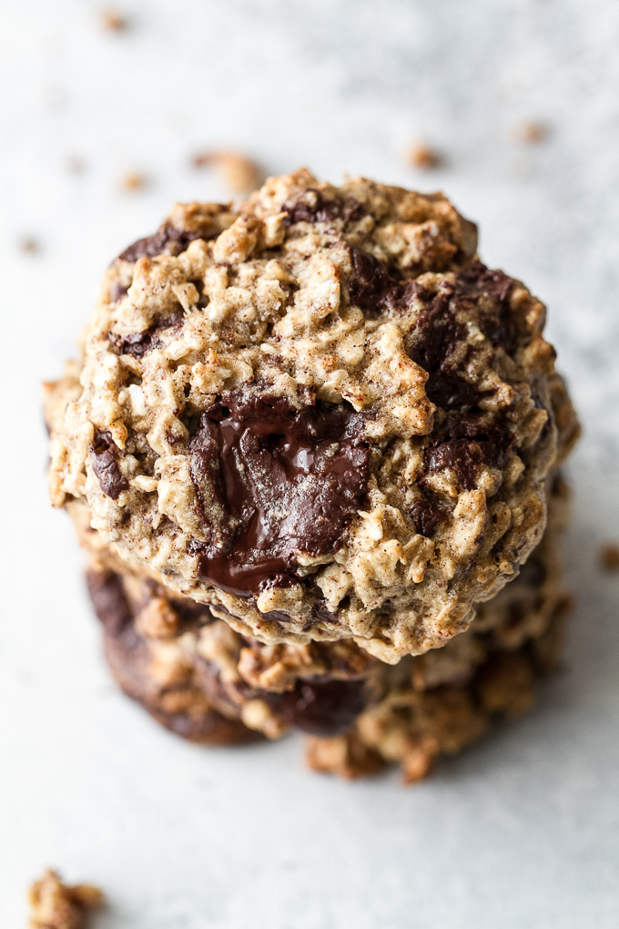 Chocolate chip banana oatmeal cookies made with healthy ingredients and loaded with plenty of chocolate and oats! They're gluten-free, vegan, and make a perfect snack for any time of the day!   runningwithspoons.com