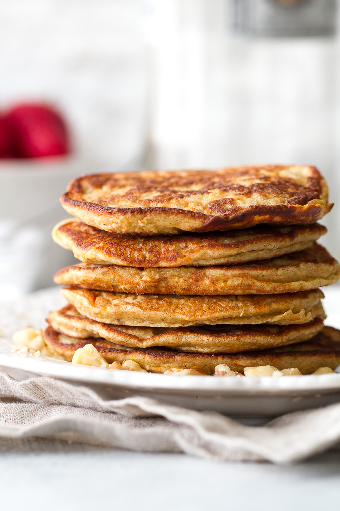 These light and fluffy Carrot Cake Greek Yogurt Pancakes are sure to keep you satisfied all morning with over 20g of whole food protein! They're gluten-free thanks to the oats and whipped up in the blender in under 5 minutes! | runningwithspoons.com