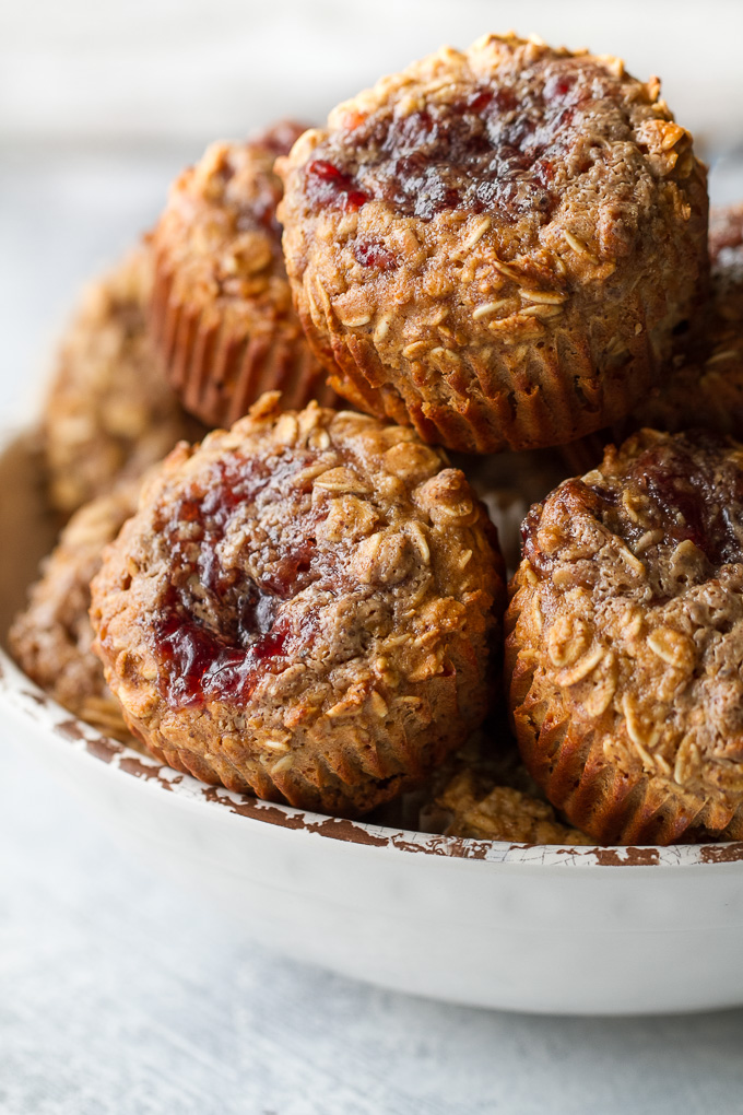 These Almond Butter and Jelly Baked Oatmeal Cups are gluten-free, refined sugar-free, super easy to make, and pack almost 6g of protein! A perfect breakfast or snack. | runningwithspoons.com