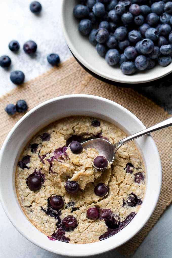 Blueberry Banana Breakfast Bake - like a muffin in a bowl, but made without any butter, oil, or refined sugar! Gluten-free and vegan so everyone can enjoy | runningwfithspoons.com