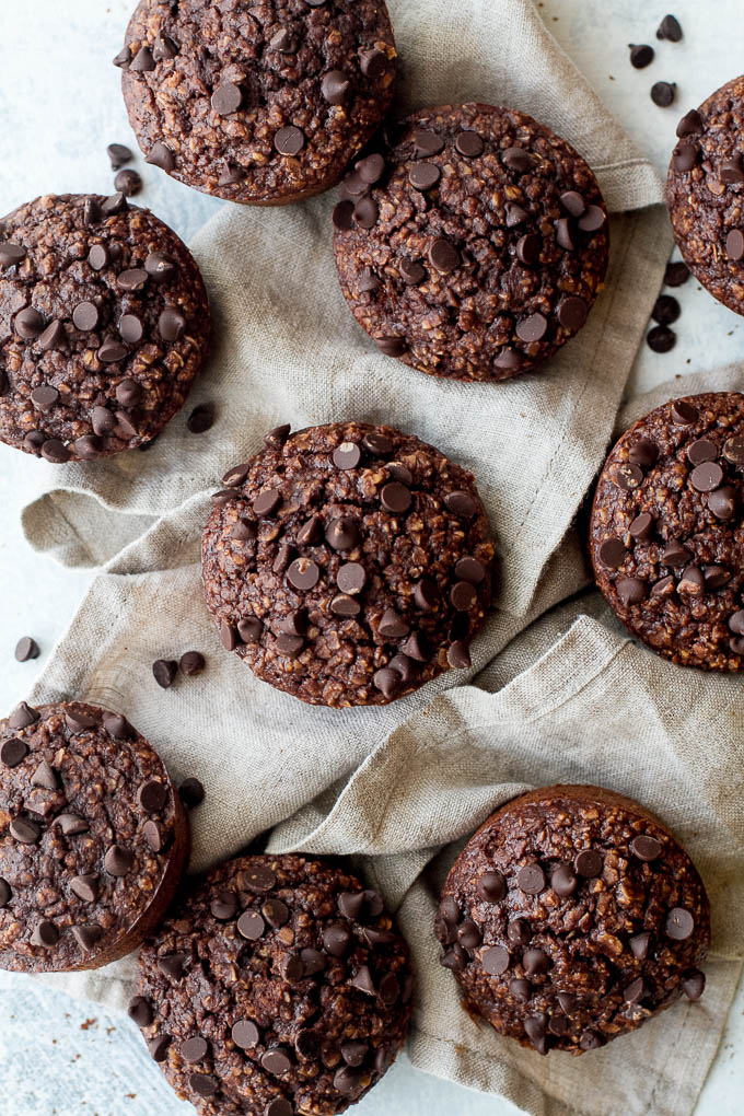 Brownie Batter Breakfast Muffins that are naturally sweetened and loaded with chocolate flavour! They're a deliciously healthy way to start your day or pull out whenever you need a satisfying snack   runningwithspoons.com