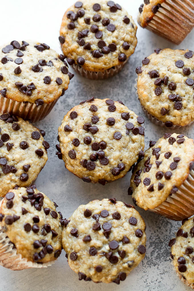 One Bowl Chocolate Chip Banana Oat Muffins - so soft and tender that you'd never guess they're made without butter or oil. Deliciously healthy and SUPER easy to whip up using just one bowl! | runningwithspoons.com