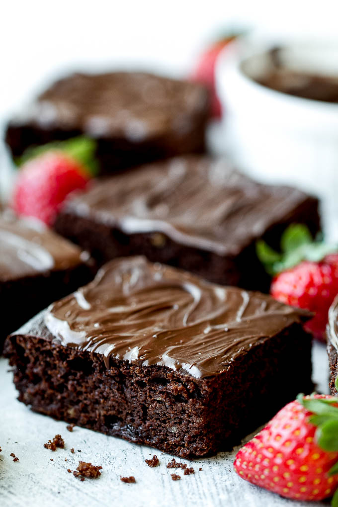 Flourless Strawberry Brownies made in one bowl with super simple ingredients! They're grain-free, oil-free, and refined-sugar-free, so they make a deliciously healthy gluten-free and paleo treat for when those chocolate cravings hit | runningwithspoons.com