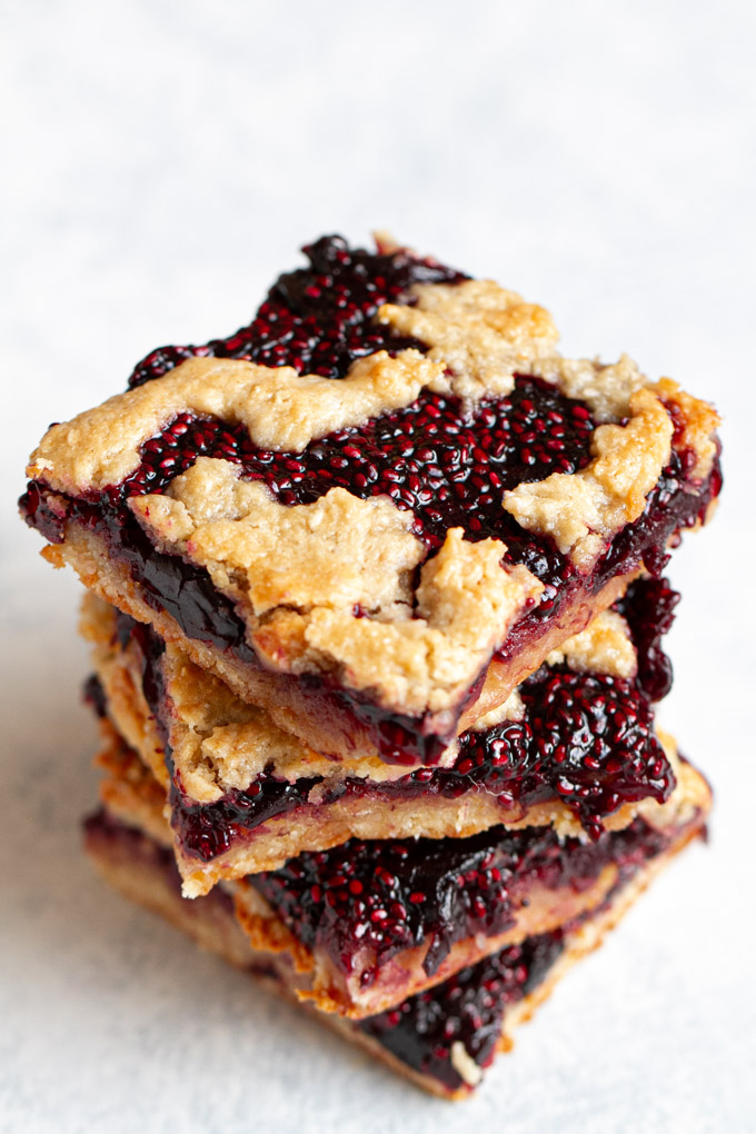 "Cherry Almond Oat Bars - so tender and ""buttery"" that you'd never guess they were made without any flour or butter! #glutenfree #vegan #recipe #healthy #snack"