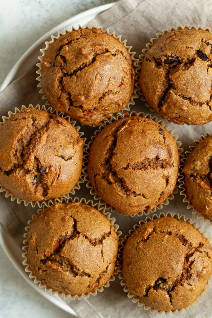 Easy Morning Glory Muffins that are so tender and loaded with flavour, you'd never know they were made without flour, oil, eggs, or refined sugar.