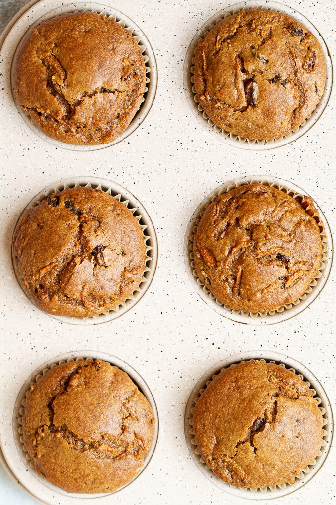 Flourless carrot cake muffins in a baking pan without any frosting.