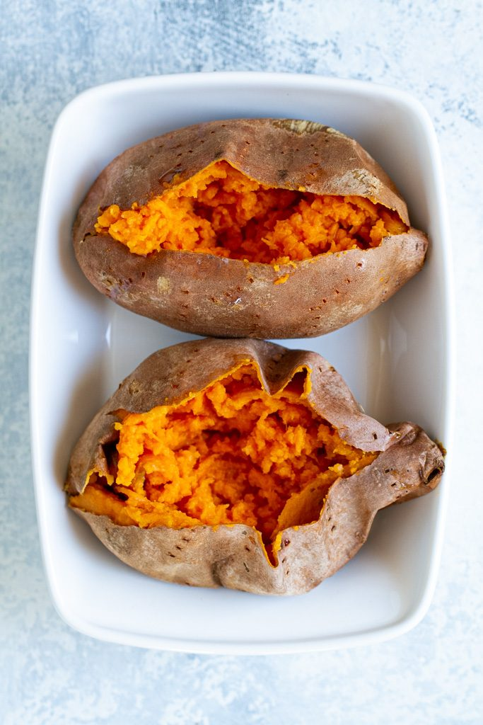 Plain sweet potatoes on a white plate.