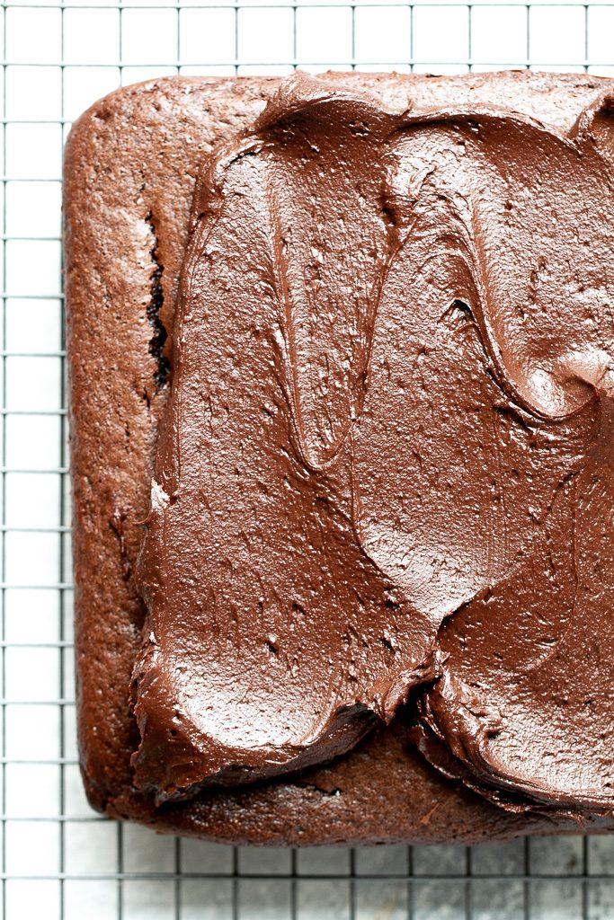 Easy chocolate sheet cake being frosted.