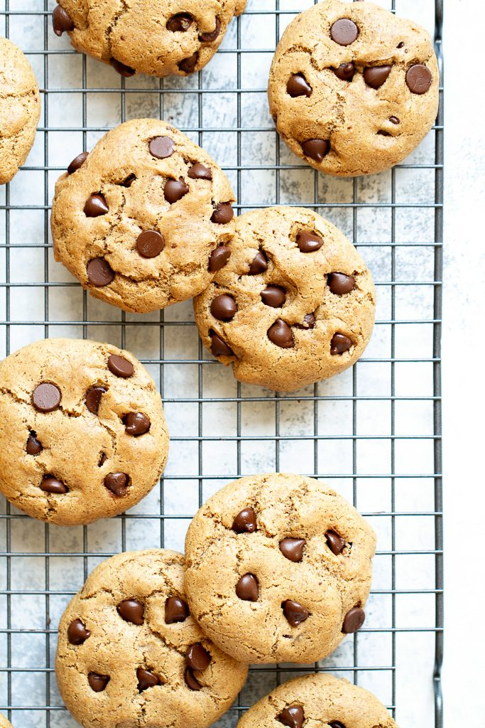 Flourless chocolate chip cookies on a cooling rack.
