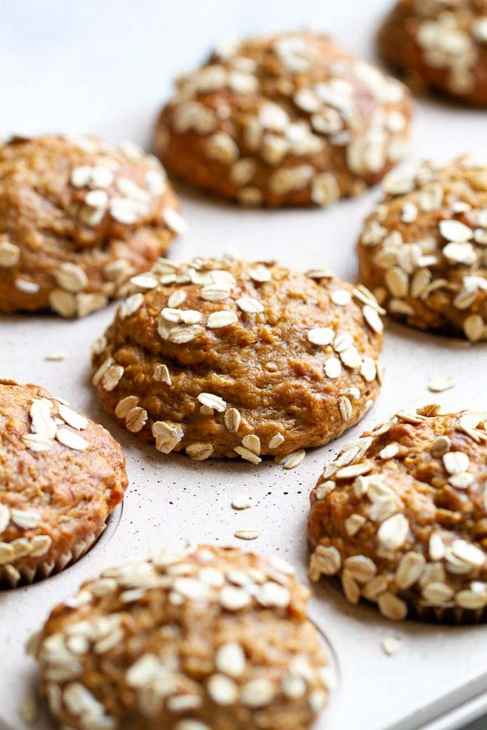 Healthy banana oat muffins in a muffin pan.